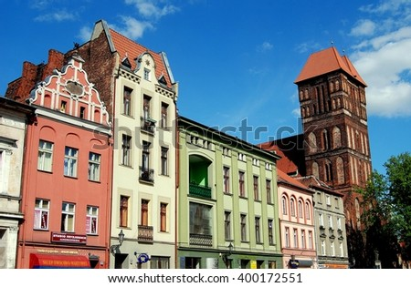 Torun, Poland - May 25, 2010: View of the New Town Square with its colourful 18th and 19th century houses and Church of St. James