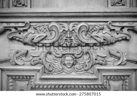 Torun, Poland - wooden door art detail. Artistic background texture. Black and white tone - retro monochrome color style.