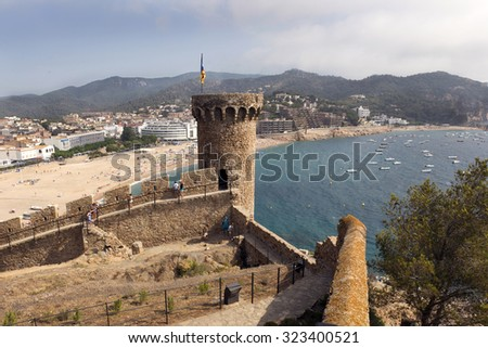 TOSSA DE MAR, JULY 16, 2015: Tossa Beach, famous destination in Spain, is located by Tossa de Mar in Catalonia in Costa Brava region. City is distanced 105 km north of  Barcelona and close to Girona. - stock photo