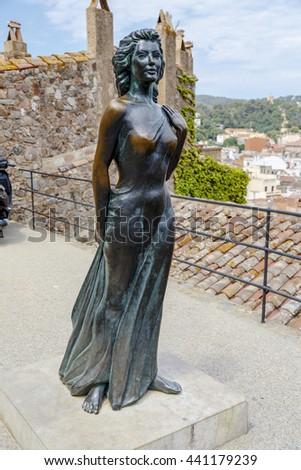 Tossa de Mar, Spain - May 31, 2015: Bonze statue of American actress Ava Gardner in the Spanish town of Tossa de Mar. - stock photo