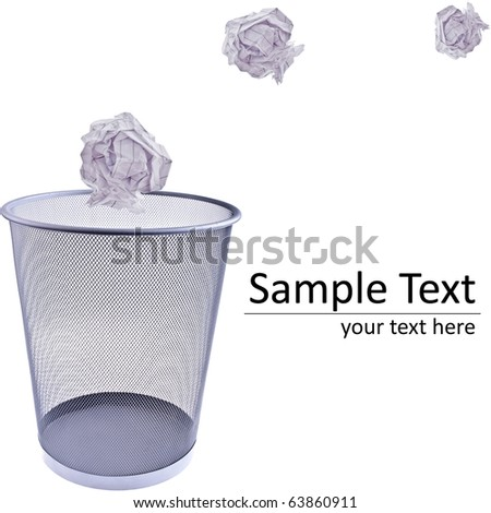 Tossing Paper into a wastebasket, completely isolated on white - stock photo