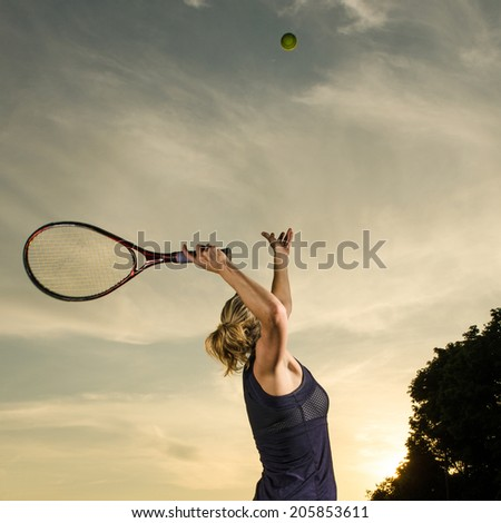 Tossing the ball for the serve - stock photo