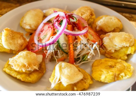 tostones with salad, typical nicaraguan cuisine