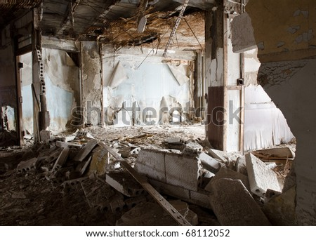 total decay of interior room of abandoned building - stock photo