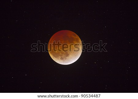 Total moon eclipse and stars - stock photo