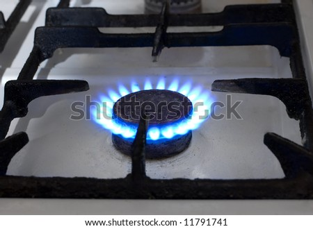 Totalitarian past: flame of an old gas stove - stock photo