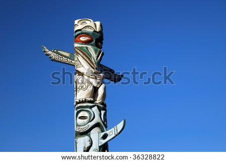 Totem pole against a blue sky - stock photo