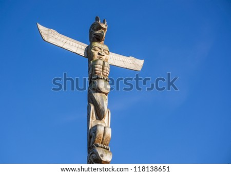 Totem pole in Vancouver, British Columbia, Canada - stock photo