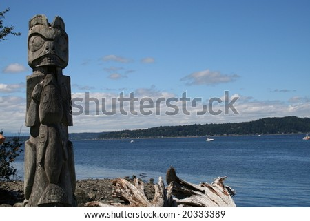 Totem pole on Blake Island near Seattle, Washington overlooking the waters of Puget Sound