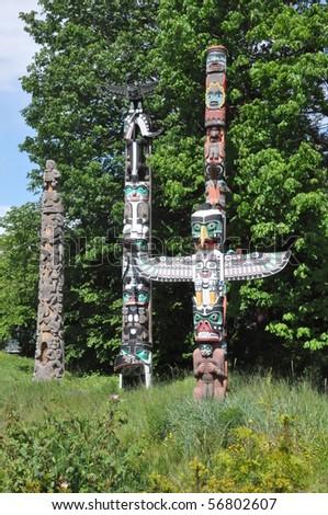 Totem Poles in Stanley Park in Vancouver, Canada - stock photo
