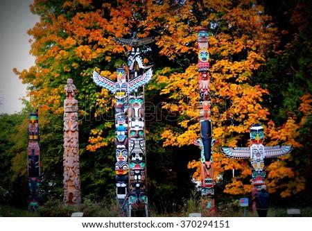 Totem poles in Stanley Park,Vancouver - stock photo