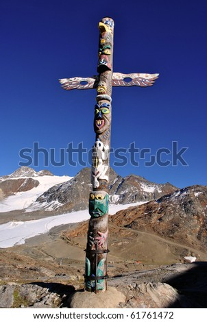 totem shaped wooden cross with human figures - stock photo