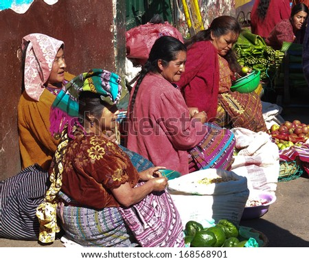 TOTONICAPAN, GUATEMALA -  NOVEMBER 28: Old women, wearing the traditional headdress,at the market of the town center,  on November 28, 2013, in Totonicapan, Guatemala.  - stock photo