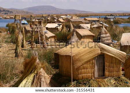 Totora houses on the floating islands of Uros, Peru - stock photo