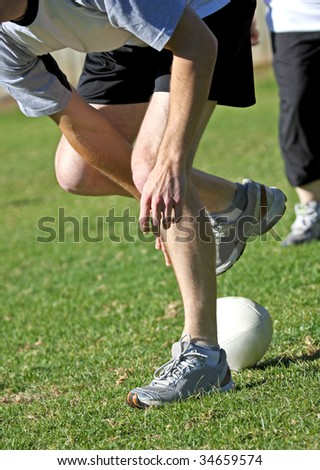 Touch Footy - Playing the football after a tackle - stock photo