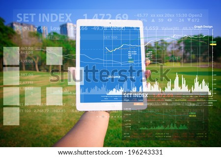 Touch pad and graph report - stock photo