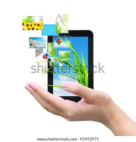 touch pad PC and streaming images virtual buttons on women hand - stock photo