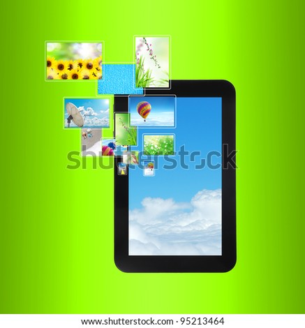 touch pad PC with streaming images on green - stock photo