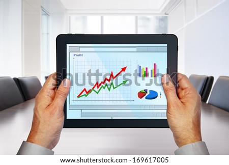 touch pad with computer graphics on screen in hands - stock photo
