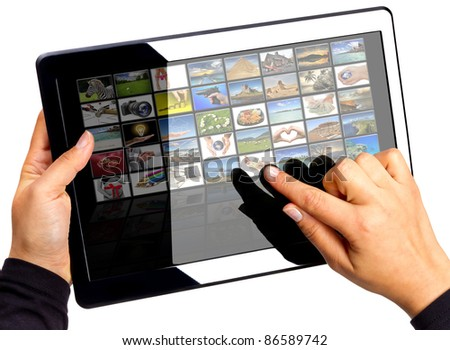 Touch pad with multimedia icons on the screen. All photos coming from my gallery. - stock photo