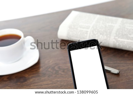 touch phone with isolated screen on a table at a businessman in office - stock photo