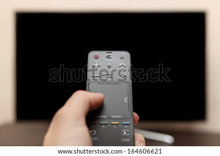 Touch remote control for smart tv - stock photo