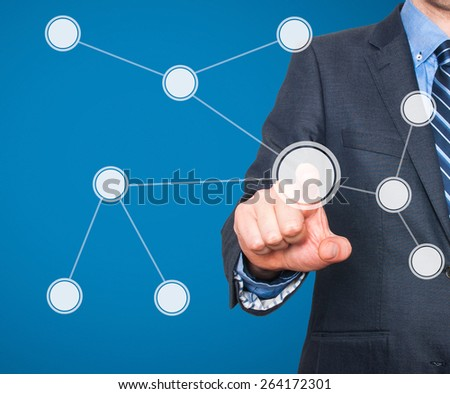Touch screen concept. Businessman push diagram button. Isolated on blue background - Stock Image