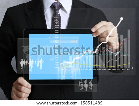 touch screen graph on tablet in hands businessmen