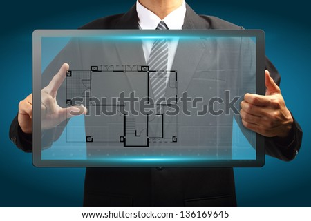 Touch screen interface House blueprints in the hands of businessmen - stock photo