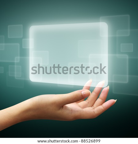 touch screen interface on woman hand - stock photo