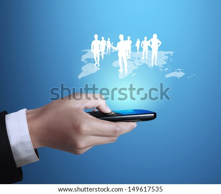 Touch screen mobile phone in hand with businessmen  - stock photo