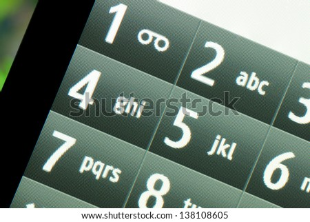 Touch screen mobile phone on which the keyboard. - stock photo