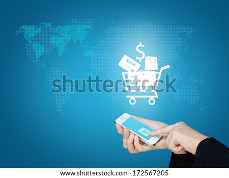 Touch screen mobile phone to display cart shopping, Design concept of technology information and e-commerce  - stock photo