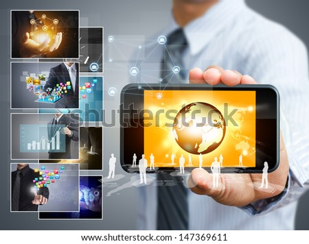 Touch screen mobile phone with business concept - stock photo