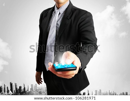 Touch screen mobile phone with businessmen - stock photo