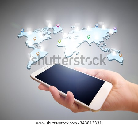 Touch screen smartphone in hand - stock photo