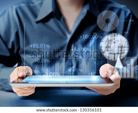 touch screen tablet and shows tablet in hand With graph - stock photo
