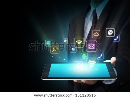 Touch screen tablet with cloud of colorful application icons - stock photo