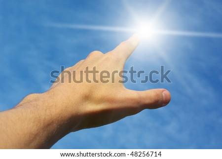 Touch the sun. Conceptual design. - stock photo
