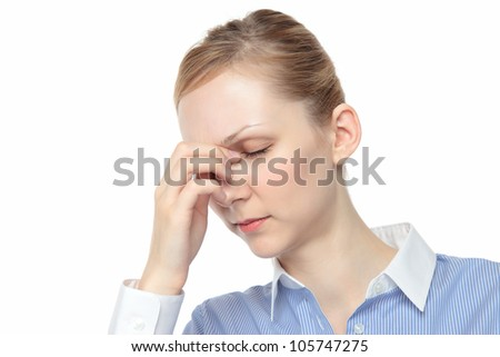 Touch the tears of young Caucasian woman white background - stock photo