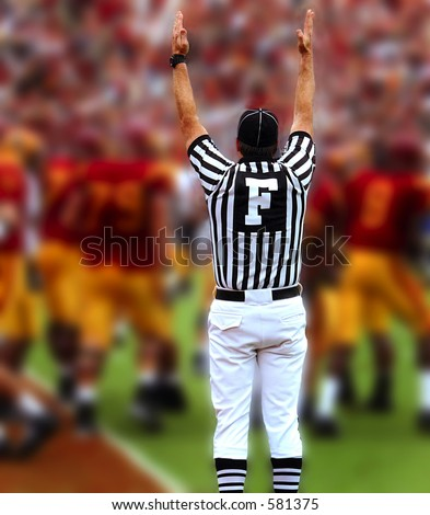 Touchdown, Referee with hands up - stock photo
