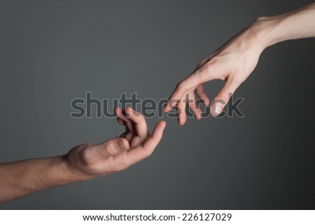 Touching Hands - stock photo