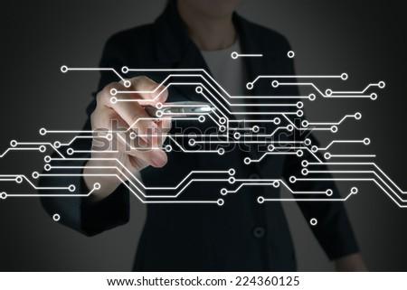 touching screen interface on circuit board  - stock photo