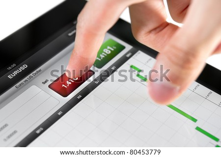 Touching sell button on stock market EUR/USD pair on a touch screen device.