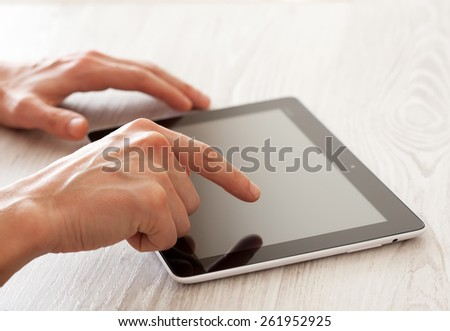 Touching tablet pc - stock photo