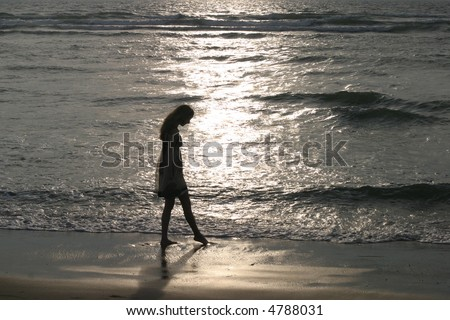 Touching the Light - Sunset at the seashore on the Atlantic coast, France. - stock photo