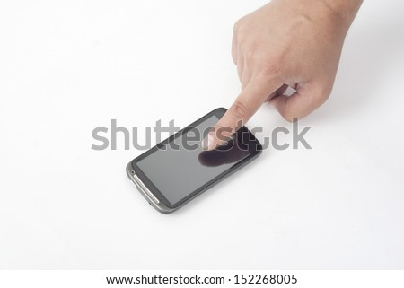 touching the smart mobile phone on the desk