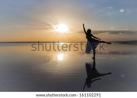 Touching the sun - stock photo