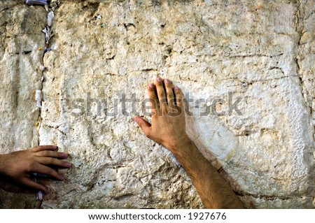 Touching the wailing wall (western wall), Jerusalem, Israel - stock photo