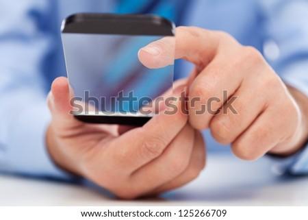 Touchscreen futuristic transparent gadget in businessman hands - stock photo